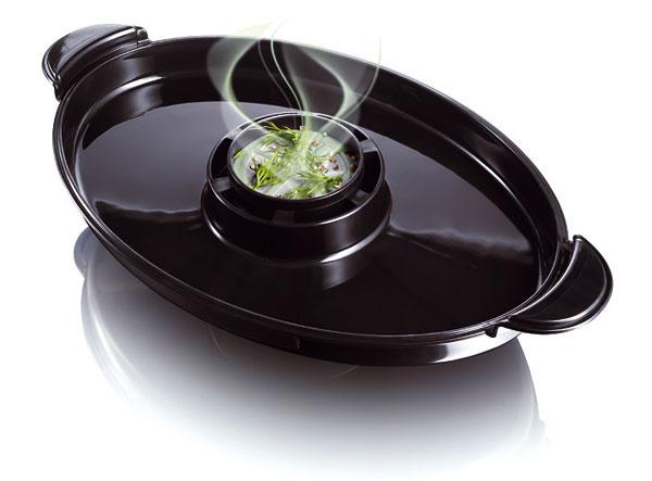 Arómu pokrmov môžete zlepšiť aj tak, že do prídavného košíka blízko parnej nádoby pridáte bylinky alebo korenie. Nie všetky typy hrncov však tento košík majú.  ZDROJ: Philips