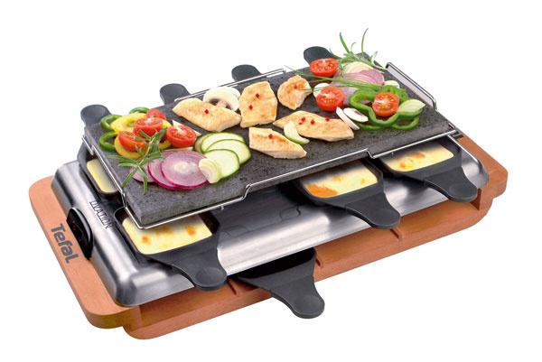 Raclette-pierrade Tefal Ovation PR60001 spríkonom 1 100W. Kamenná grilovacia doska, 8 panvičiek snepriľnavým povrchom, kombinácia dreva anehrdzavejúcej ocele, rozoberateľný sľahkou údržbou, tepelne izolované rukoväte panvičiek, veľkosť dosky 36 × 18 cm. Cena 114,90 €.