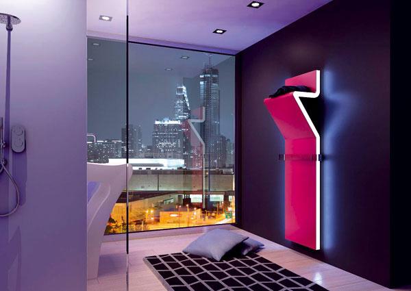 Trojdimenzionálna línia zdielne Synthesis Design. Elegantná funkčnosť – odkladací priestor avyhrievacie teleso zároveň. Ventily ukryté za radiátorom Tratto od spoločnosti Irsap nerušia efektný jedinečný dizajn. Bočné steny možno vybaviť LED diódami. Cena od 3 308 €.