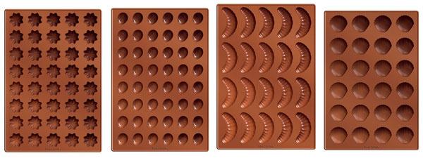 Silikónové formy Delícia na rôzne tvary pečiva (napr. 20 vanilkových rožkov, 48 orieškov, 40 hviezdičiek, 24 mušličiek), pružný ažiaruvzdorný silikón (230 °C), vhodný do všetkých typov rúr, umývačky aj chladničky. Cena 8,50 €/ks. Predáva tescoma.sk.