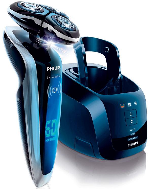 Elektrický holiaci strojček Philips RQ1290/23 Senso Touch 3D, akumulátorový, rýchle nabíjanie, kopírovanie obrysov GyroFlex 3D, holiace hlavy UltraTrack, Speed XL, výmenné holiace hlavy RQ12, systém DualPrecision, patentovaná technológia Super Lift & Cut, SkinGlide minimalizuje podráždenie pokožky, ergonomické uchopenie Easy Grip, akumulátor Li-ion, automatická voľba napätia 100 – 240 V, LED displej, cestovná zámka, nabíjací stojan, Systém Jet Clean s3 nastaveniami čistenia: automatické na normálne použitie, eco (spotreba nižšia o40 %) aintenzívne. Luxusné puzdro adarčekové balenie. Cena 389 €.