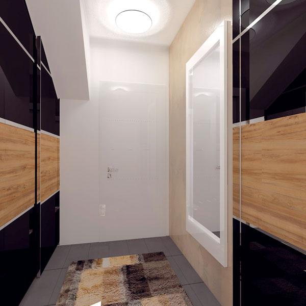 Pohľad smerom kdverám do kuchyne. Vľavo vstavaná skriňa pod schodmi avstupné dvere.