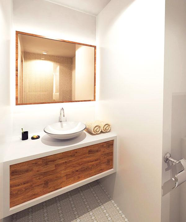 Proporcie skrinky pod umývadlom priestor odľahčujú, azároveň vytvárajú dostatok odkladacej plochy. Zrkadlo je podsvietené úsporným aelegantne pôsobiacim LED pásom.