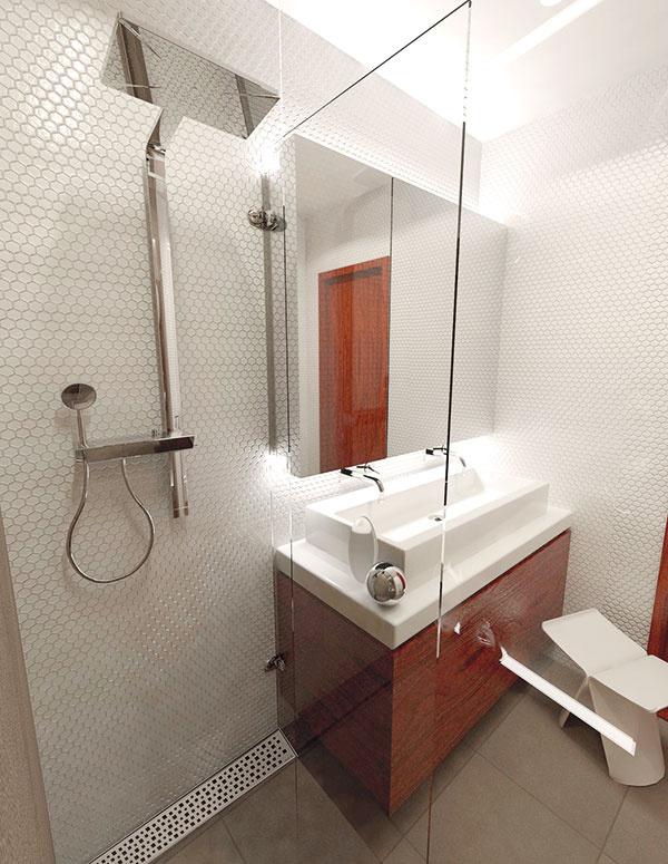 Nástenná sprchovacia súprava shornou aj ručnou sprchou tvarovo korešponduje snástennými umývadlovými batériami. Odtokový žľab na šírku sprchového kúta pohodlne odvedie vodu, musí však byť zabezpečené dostatočné tesnenie dverí.