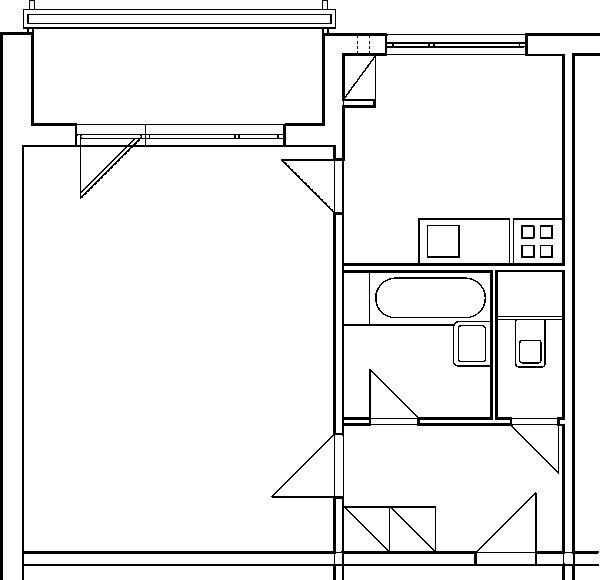 Súčasný pôdorys bytu Keďže jednoizbový byt je určený jednému až dvom obyvateľom, spojenie kúpeľne aWC do jednej miestnosti tu určite nebude prekážať. Takéto riešenie pritom prinesie pozitíva ako na strane kúpeľne – bude väčšia alepšie využiteľná –, tak aj na strane chodby, kde ubudnú jedny dvere atento priestor sa bude dať využiť napríklad na umiestnenie skriniek či vešiakovej steny.