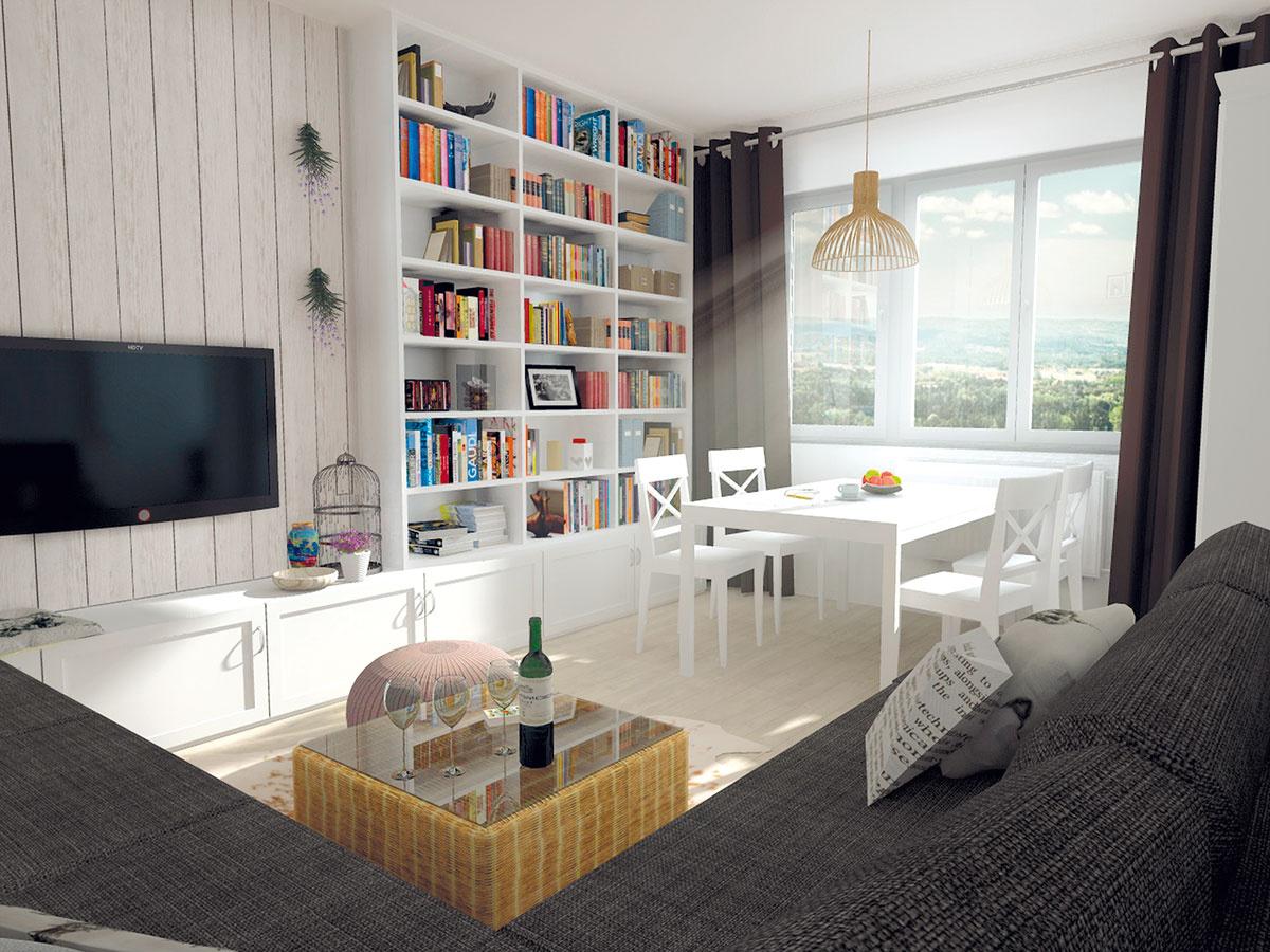 Biela drevená knižnica je vyrobená na mieru. Police sú zámerne jednoducho delené, spodná časť je tvarovaná aplynule prechádza až pod TV.