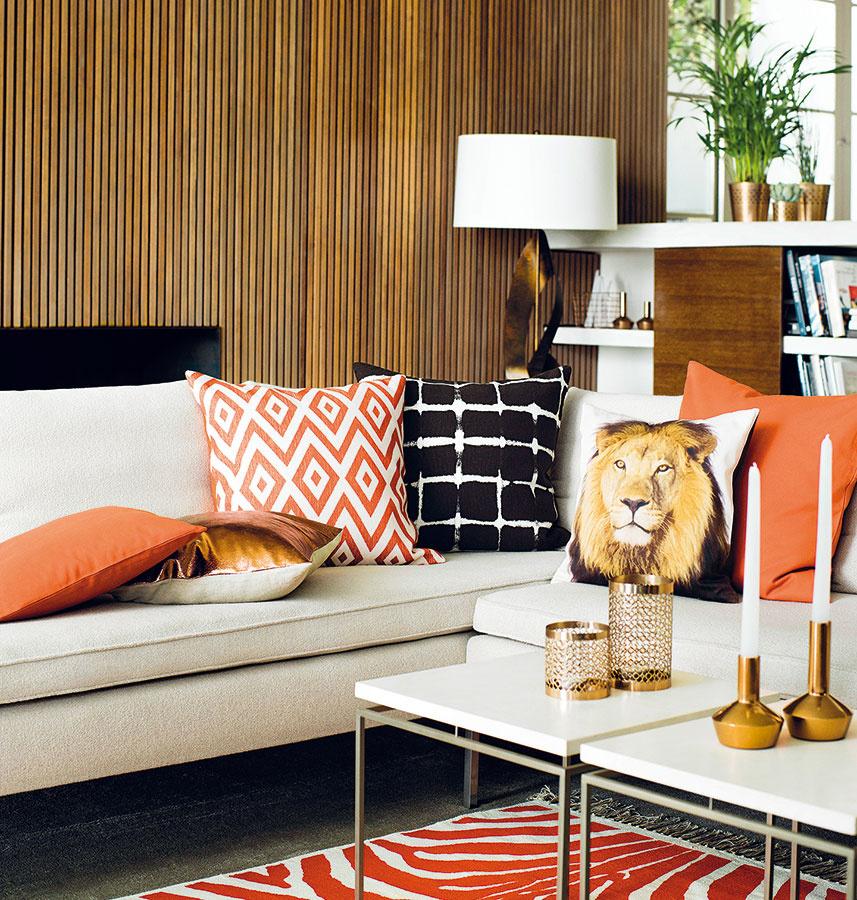 Hnedá, medená aoranžová pôsobia vľúdne, takže modernú obývačku zjemnia azútulnia.