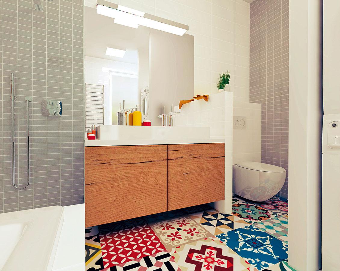 Skrinka pod umývadlom vdekóre prírodného orecha štýlovo ladí sdlažbou aposkytuje dostatok priestoru na všetky hygienické potreby adrogériu.