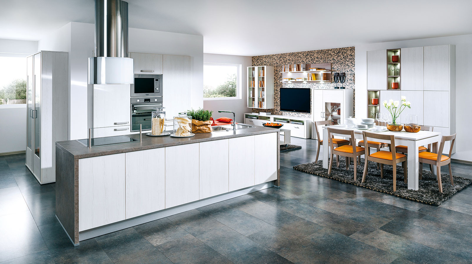 Závesný ostrovný variant je azda najsamostatnejším členom rodiny odsávačov. Je preto zaujímavým kuchynským prvkom vhodným do otvorenej dispozície ako model Faber Cassiopea Isola, ktorý sa stal súčasťou uhladeného bieleho interiéru zariadeného kuchyňou Zora aobývačkou Nordic od Decodomu.