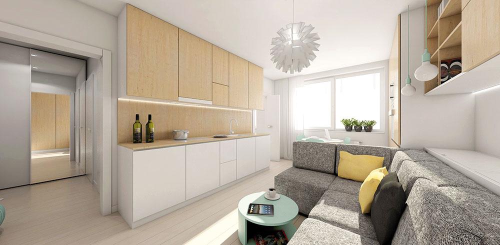 Kuchynskú linku sa architektky rozhodli presunúť zo samostatnej miestnosti do obývacej izby. Uzavreté police pôsobia jednoliatym čistým dojmom, čo malému priestoru prospieva.