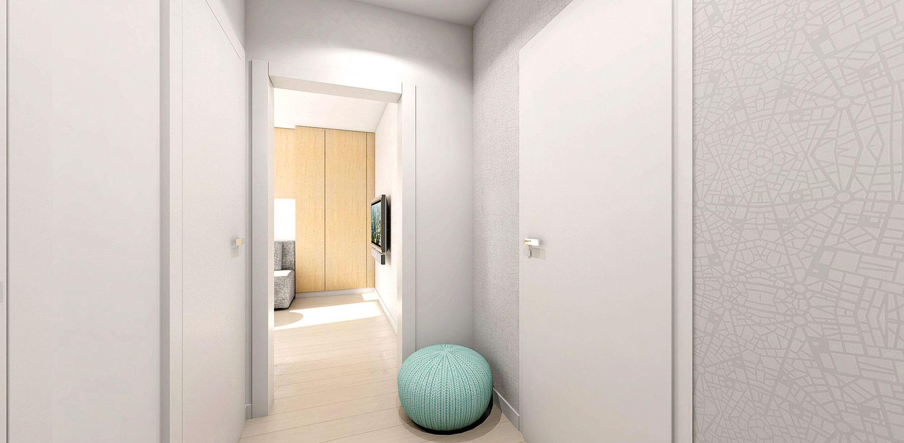 Na stenách chodby, vobývacej izbe aj za posteľou vspálni sa nachádza biela tapeta sjemným vzorom, ktorá priestor zmäkčuje azútulňuje.