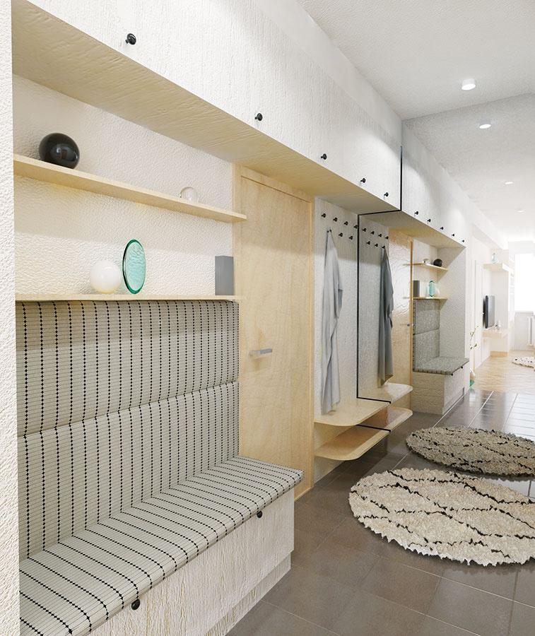 Nábytok v chodbe naplno využíva potenciál úložných priestorov. Nachádzajú sa tu otvorené police aj skrinka na topánky, vešiaky na kabáty, poličky na kľúče a drobnosti a pod stropom aj rad skriniek na sezónne oblečenie.