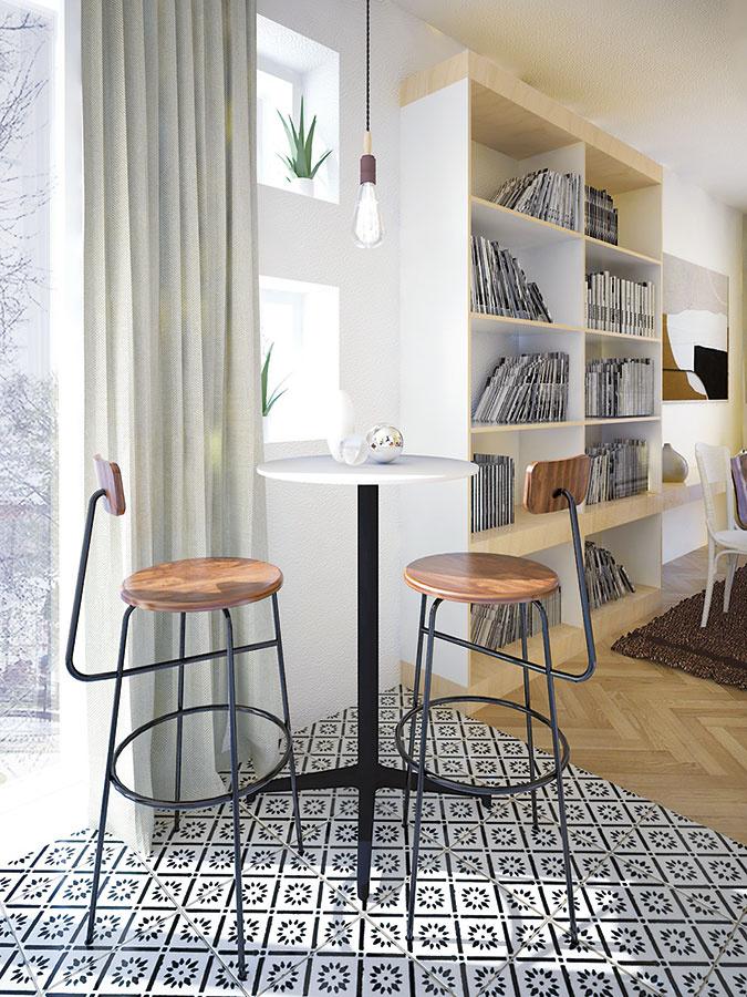 Raňajkové sedenie je vytvorené na mieste bývalej komory. Namiesto pevného nábytku na mieru ho tvorí presunuteľný barový stolík sdvomi stoličkami.