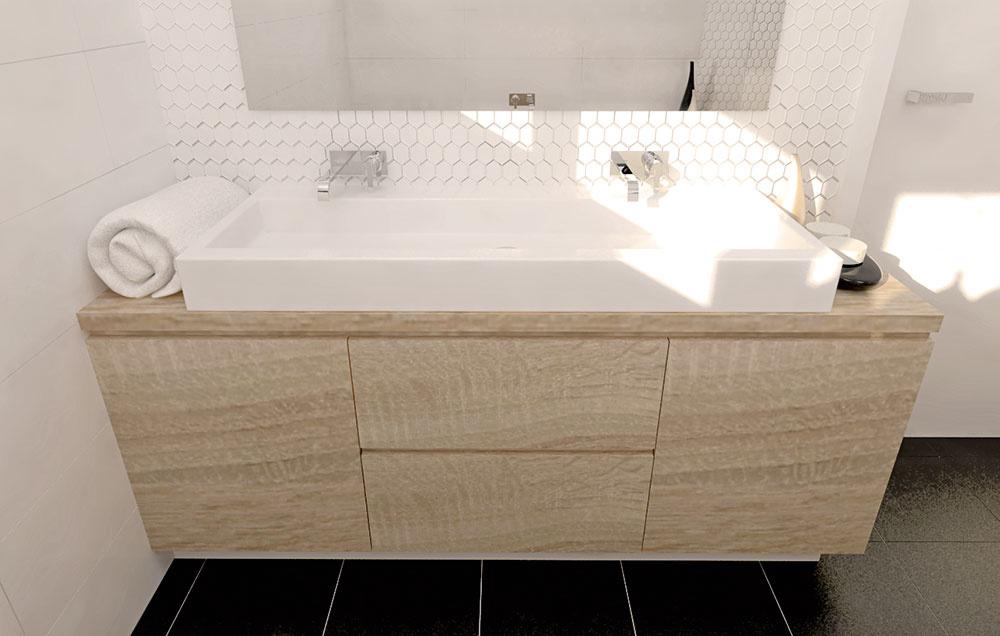 Vkúpeľni sa nachádza praktické dvojumývadlo, ktoré je vrámci prvého riešenia rovnako ako zrkadlo umiestnené stredovo. Vumývadlovej skrinke sú skryté zásuvky, kde sa okrem miesta na hygienické potreby nachádza aj priestor na sifón. Vjej ľavej časti je umiestnený poklop na zhodenie bielizne.