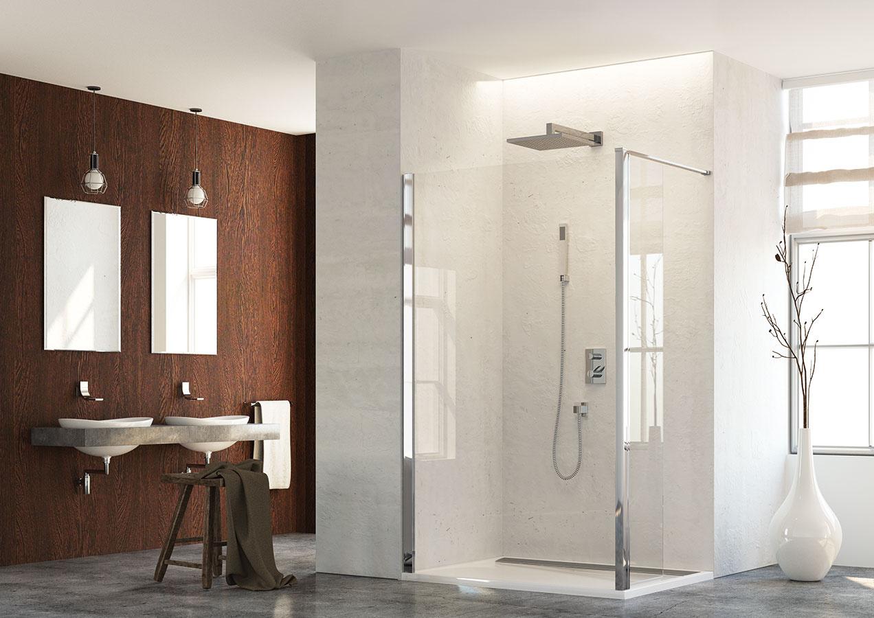 Pohodlné sprchovanie. Pevná zástena TOPF od značky SanSwiss umožňuje pohodlný široký vstup do sprchového kúta aposkytuje pri sprchovaní veľkorysý priestor. Je vyrobená zbezpečnostného skla hrúbky 6 mm aje štandardne dostupná všírke 70 až 120 cm. Dopĺňa sa stabilizačnou alebo stropnou vzperou.
