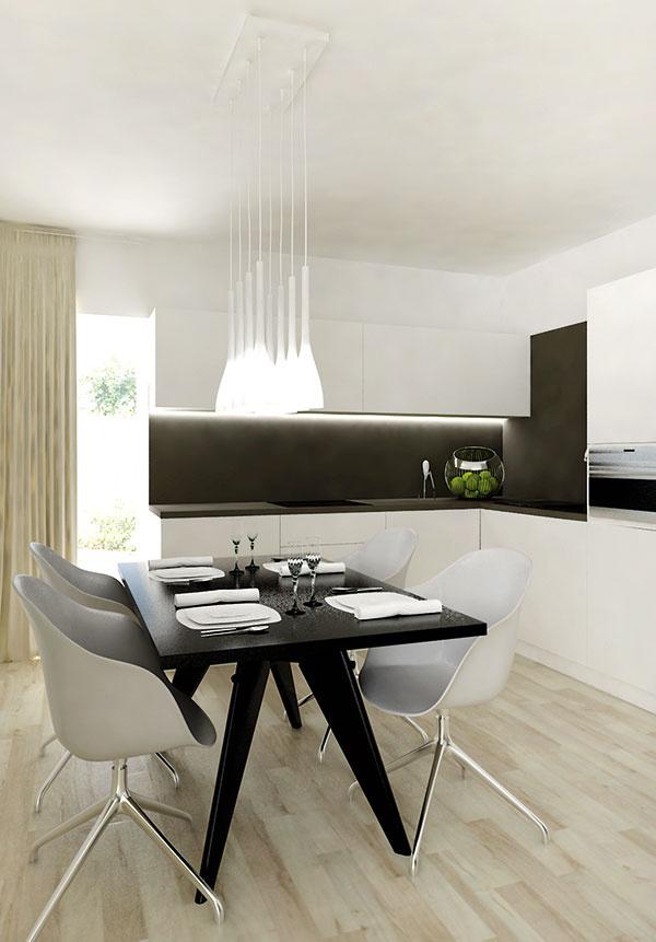 Svetlá podlaha umožnila architektovi častejšie siahnuť po tmavých až čiernych kusoch nábytku apovrchoch bez toho, aby interiér ako celok pôsobil tmavo. Jej jemne béžovou farbou sa inšpiroval pri výbere závesov či obrazov.