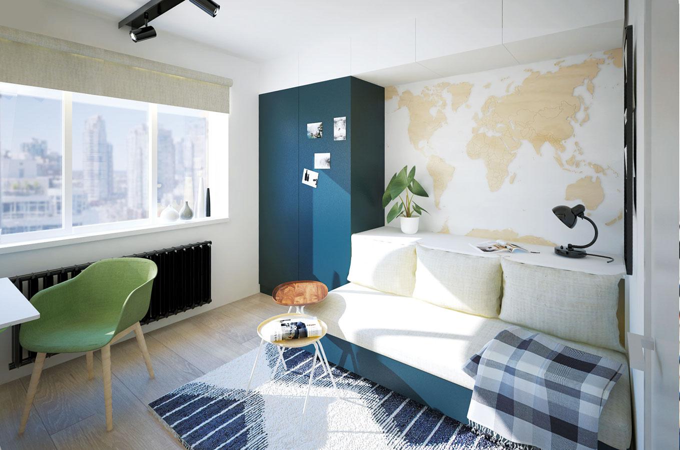 Multifunkčná nábytková stena tvorí celok zastupujúci úložné priestory, sedačku aj posteľ. Modrá farba podporuje cestovateľskú náladu vinteriéri.