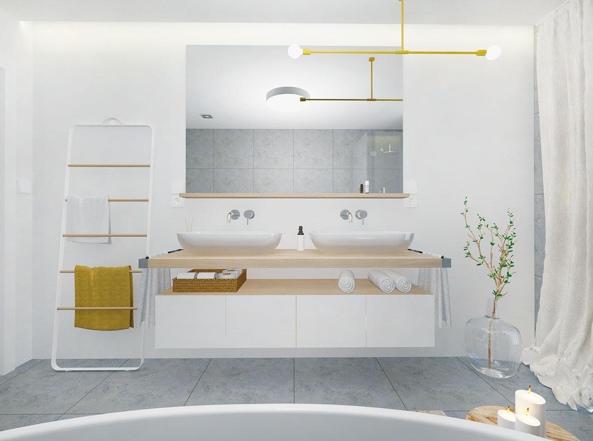 Gresový obklad, ktorý je charakteristickým prvkom celej kúpeľne, nahrádza vprípade steny so zrkadlom biela vodovzdorná stierka.