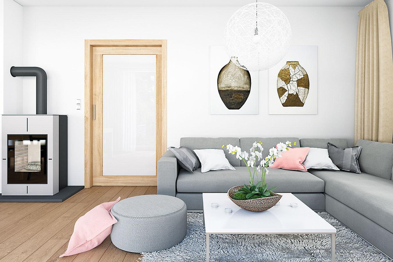 Požiadavkou majiteľov boli aj kozubové kachle umiestnené medzi jedálenskou a obývacou časťou. Vďaka jednoduchému modernému dizajnu a sivej farebnosti do priestoru výborne zapadli.