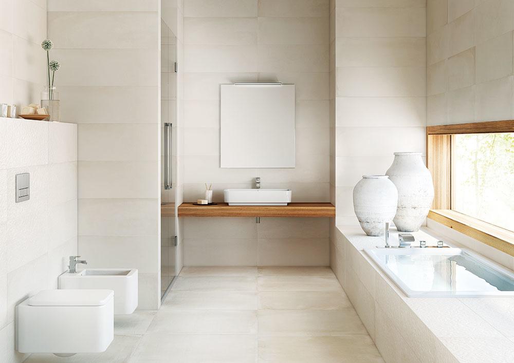 Svetlé farby malú kúpeľňu opticky zväčšia. Použite obdĺžnikový obklad sväčším rozmerom vhorizontálnom smere aveľkoformátovú dlažbu, aby sa priestor spájal, nie rozdeľoval škárami. Dôležité je dostatočné osvetlenie, na ktorom vprípade malej kúpeľne rozhodne nešetrite.