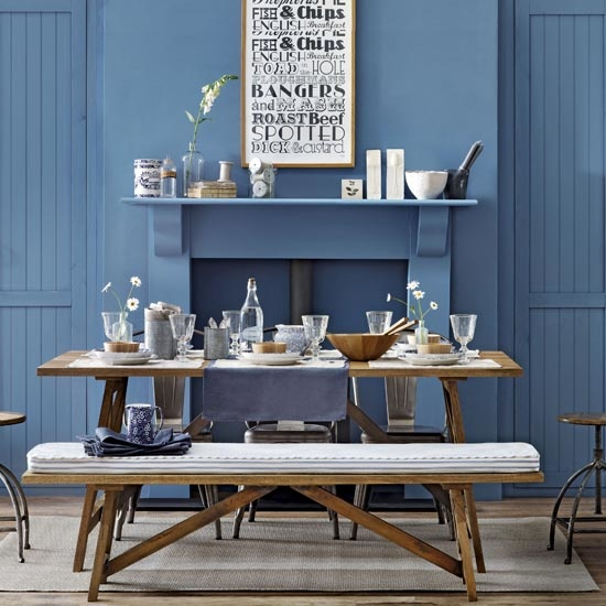 Blue dining room, fireplace and chimney breast, tongue and groove panelled doors, rustic wooden table and bench seating, industrial style reclaimed stools, IH 09/2013 Pub Orig