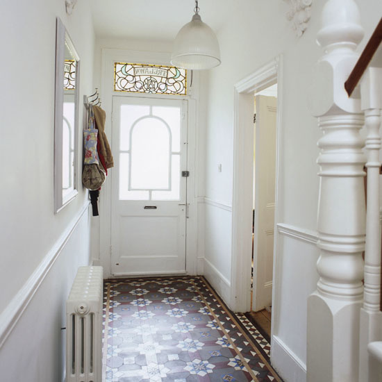 all white  hallway front door original floor tiles stained glass window pendant lamp shade light  pub orig  25 BH 03/2007 p150 real home