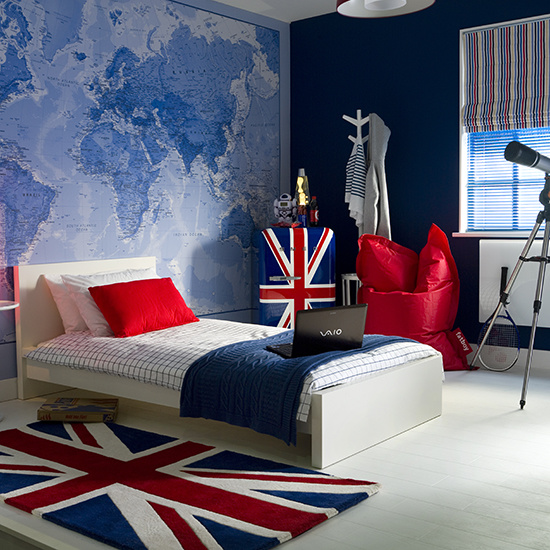 Boys bedroom, Union Jack rug, single bed with blue throw and red pillow, Union jack fridge, bright red fatboy beanbag, mural wall with blue map of the world, telescope. IH 08/2010 Pub orig
