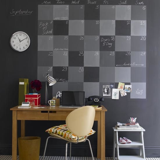 Chalkboard calendar in home office, laptop, desk, striped carpet.  IH 09/2009 Pub orig