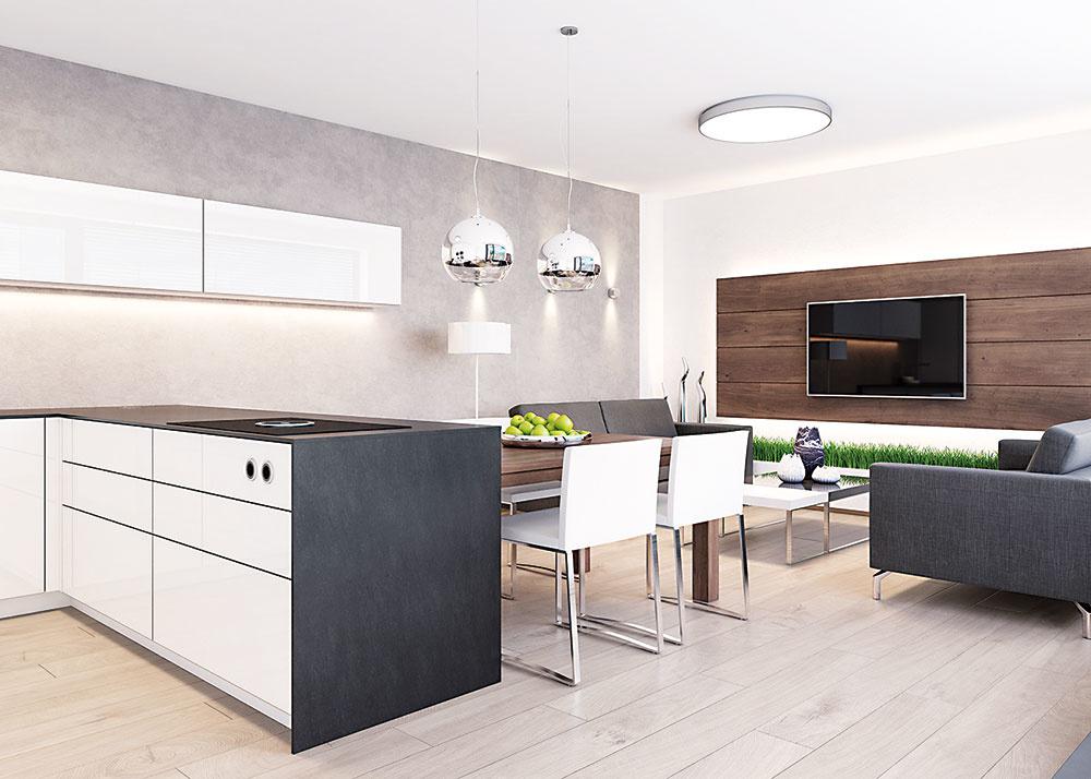 Kuchyňa je s obývacou časťou spojená aj prostredníctvom sivej stierky, ktorá je nasvietená viacerými svetelnými zdrojmi. Rovnaká stierka sa v menšej miere objavuje aj pri vstupe do priestoru.