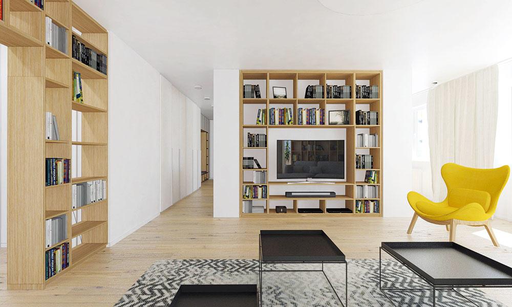 Typový nábytok prevažne v neutrálnych sivých odtieňoch dopĺňa zopár žltých akcentov, napríklad v podobe kresla v obývacej časti alebo svietidiel nad jedálenským stolom.