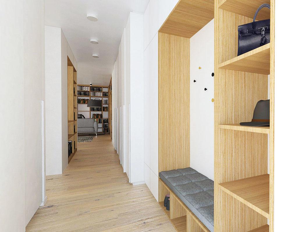 Pozdĺž celej chodby sa nachádza nika vyplnená úložnými priestormi. Priamo pri vstupe vzniklo priestranné miesto na sedenie aj vešanie kabátov. V úrovni kuchyne sa začínajú skrine s posuvnými dverami a hĺbkou 70 cm.