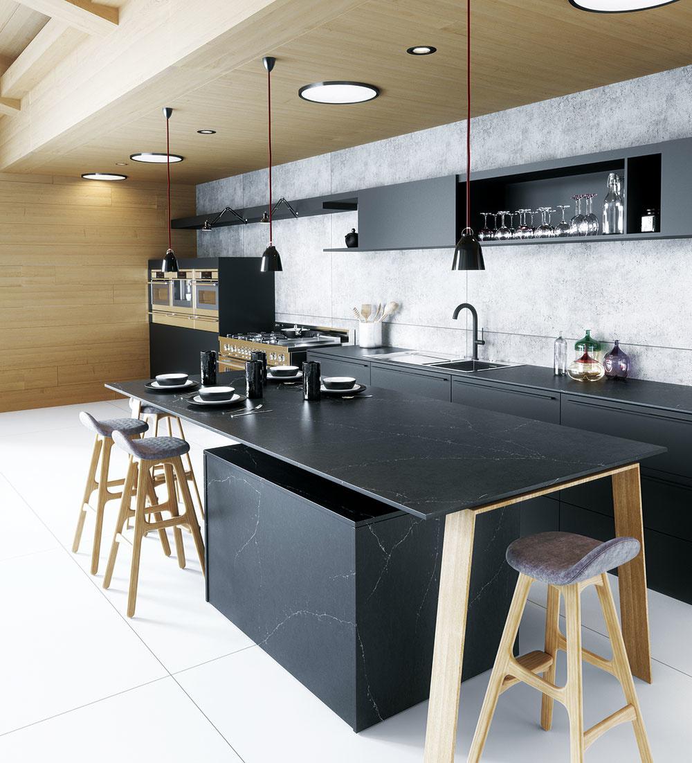 Kuchyne tón v tóne, v rámci ktorých sú dvierka linky identické alebo veľmi blízke pracovnej doske, sú obzvlášť obľúbené. Ak chcete vniesť do priestoru tmavej kuchyne jemný akcent, zvoľte napríklad pracovnú plochu s jemným motívom kameňa. Technický kameň značky Silestone od Cosentino predáva CYMORKA interior design.