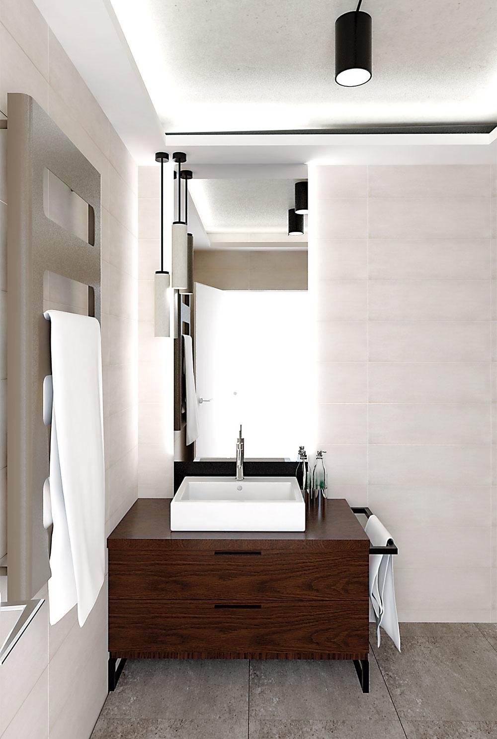 Umývadlová skrinka s dvomi zásuvkami je postavená na čiernych kovových podnožiach, ktoré pôsobia industriálne. Nadväzuje na ňu tvarovo jednoduché podsvietené zrkadlo, ktoré siaha až po podhľad.