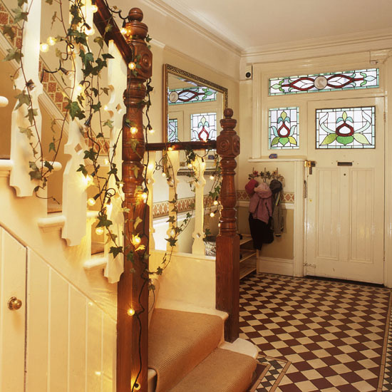 christmas hallway decorations cream fairy lights black and white tiled flooring stained glass window front door     pub orig    25 BH 12/2006 p74 real home