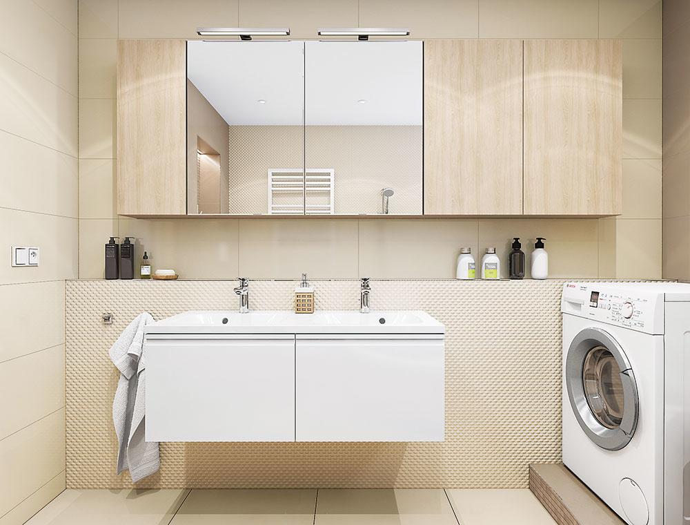 Praktická nika vznikla aj nad umývadlom. Lesklá béžová a biela v kombinácii so zrkadlami príjemne odrážajú denné i umelé svetlo.
