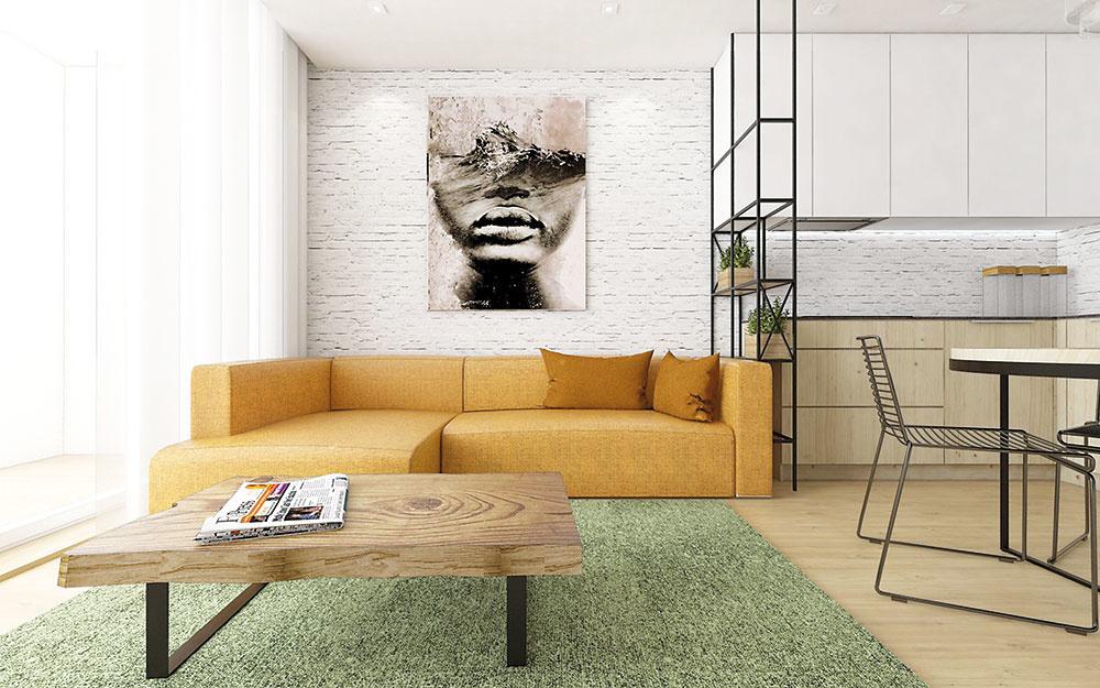 Farebný akcent vpodobe žltej sedačky našepkáva, že obyvateľom bytu je mladý človek. Hranicu medzi kuchyňou aobývacou časťou určuje subtílna, no výrazná kovová konštrukcia.