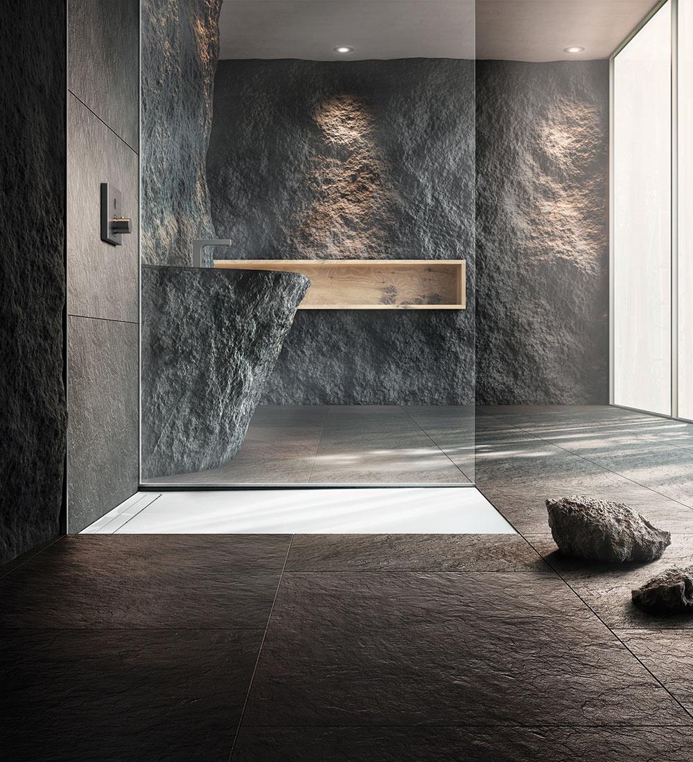 Vytesané do kameňa  Ak túžite po čomsi luxusnom aexkluzívnom, možno je pre vás tá správna voľba obklad zmramoru, bridlice, vápenca či pieskovca, či už vleštenej alebo surovej neopracovanej forme. Prírodný kameň má jedinečné odtiene, žilkovanie aštruktúru, ktorá sa nažiadnom inom kuse obkladu neopakuje. Dokonale vynikne napríklad vsprchovom kúte. Foto Kaldewei.