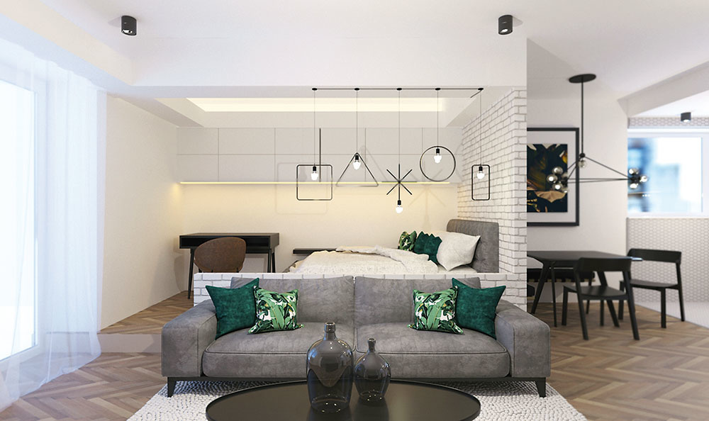 Znížené stropy a zvýšená podlahová časť za pohovkou opticky oddeľujú obytné zóny. Visiace svetlá v škandinávskom duchu nenápadne naznačujú hranicu medzi obývačkou a spálňou.