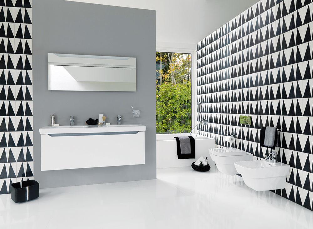 ŠTÝL 7 Čierno-biela geometria  Takáto kúpeľňa nebude nikdy strohá, keď ju zariadite vhodnými doplnkami, ktoré priestor zjemnia azútulnia. Výborne sa sem hodí moderný dizajnový nábytok, ktorý priestor vyplní azjednotí sdoplnkami vbielej, sivej alebo čiernej farbe. Veľká kúpeľňa dáva priestor pre obľúbenú zeleň vo veľkých črepníkoch, ktorá rozbije jej lineárny vzhľad.