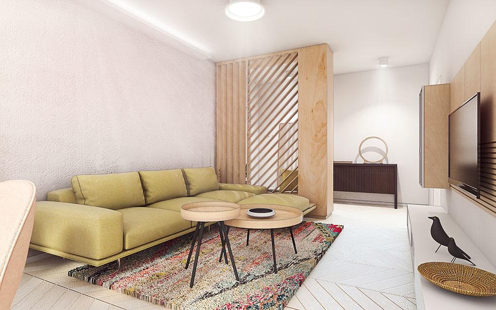 Výrazná sedačka, pestrofarebný koberec azaujímavo riešený kozub vnášajú do bytu dávku hrejivého temperamentu.