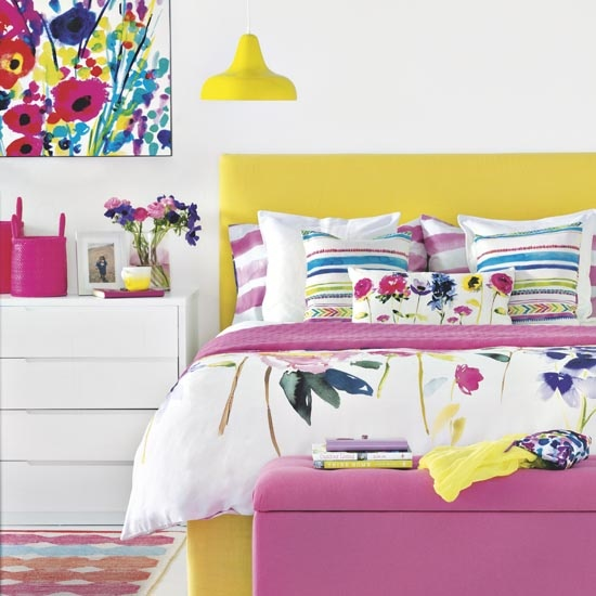 Bright summer all white bedroom with floral print canvas on feature wall, matching bedding set, pink ottoman, vibrant yellow bed frame, matching aerial pendant lamp, white chest of drawers, patterned adele rug, IH, 07/2014, Pub Orig
