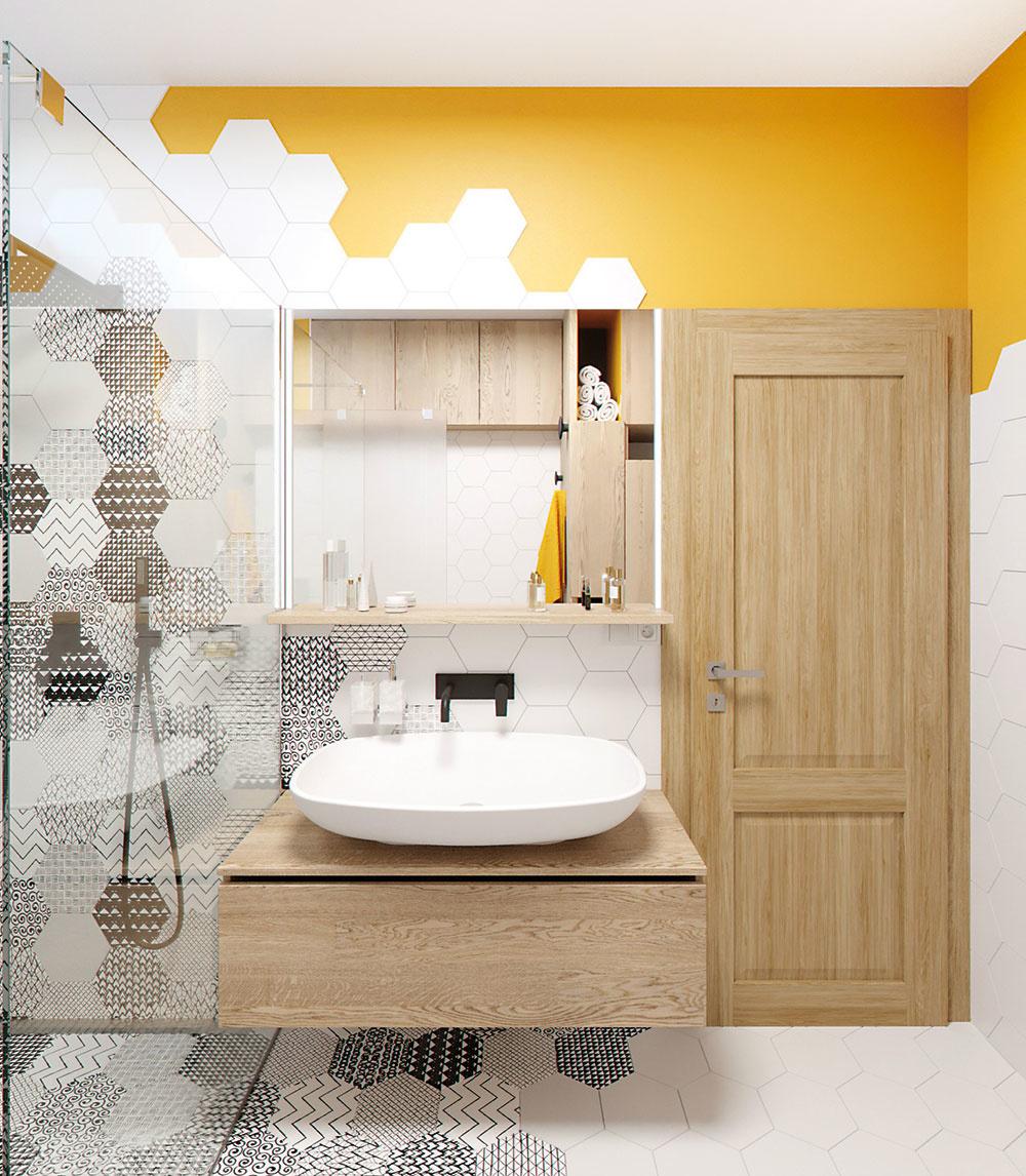Teplá žltá sa objavuje hneď na niekoľkých miestach. Nad vchodom do kúpeľne má podobu stekajúcej farby, úložné skrinky vďaka nej ožijú aje aj na vtipných vešiačikoch oproti WC.