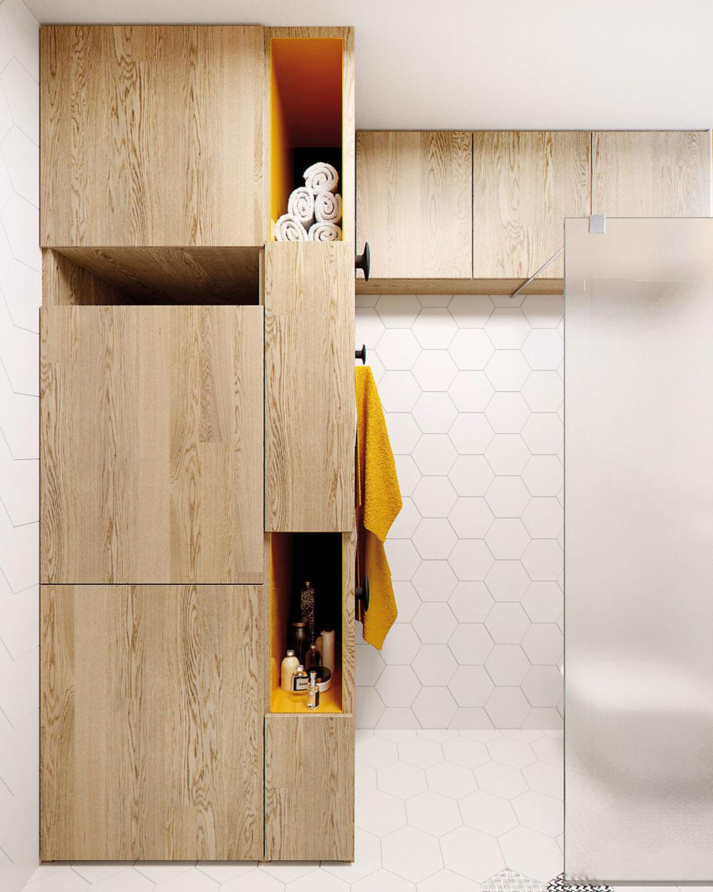 Eleganciu drevenej nábytkovej zostavy rozbíja žlté vnútro obložené lakobelom. Spolu s vešiačikmi a žltou vodoodolnou farbou nad dverami tvoria pestrý a humorný akcent.