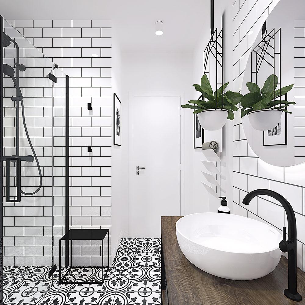 Čierna armatúra a doplnky skvelo dotvárajú žiadaný industriálny charakter. Aby však kúpeľňa nepôsobila príliš chladne, stolík pod umývadlom a poličky za WC sú navrhnuté z masívneho dreva.