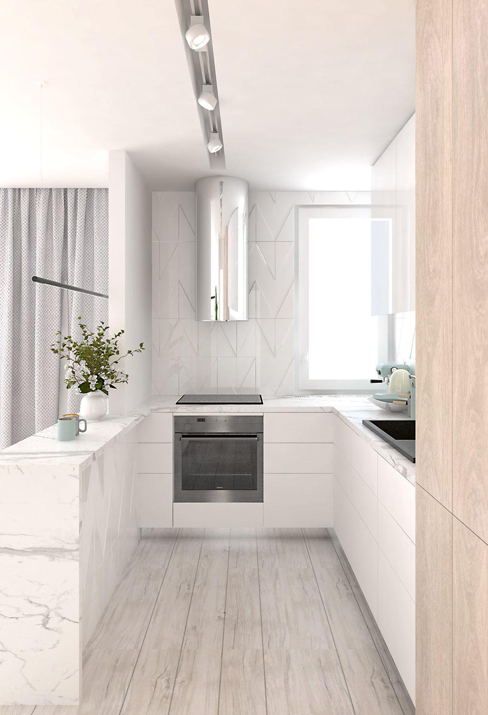 Kuchyňa vo svetlej kombinácii bielej farby, dreva a bieleho mramoru dáva vyniknúť otvorenej dennej časti.