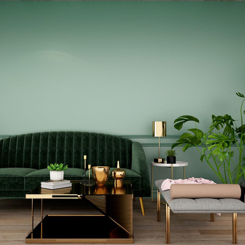 Tlmená zelená v interiéri a zelená sedačka