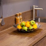 Apples and oranges on the wooden kitchen counter