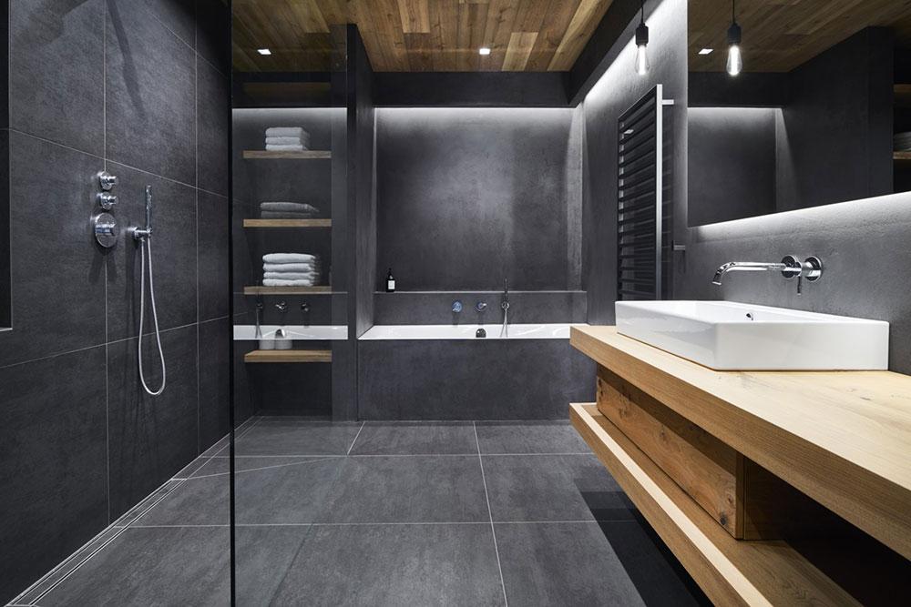 kúpeľňa s tmavosivým obkladom a sprchovým kútom