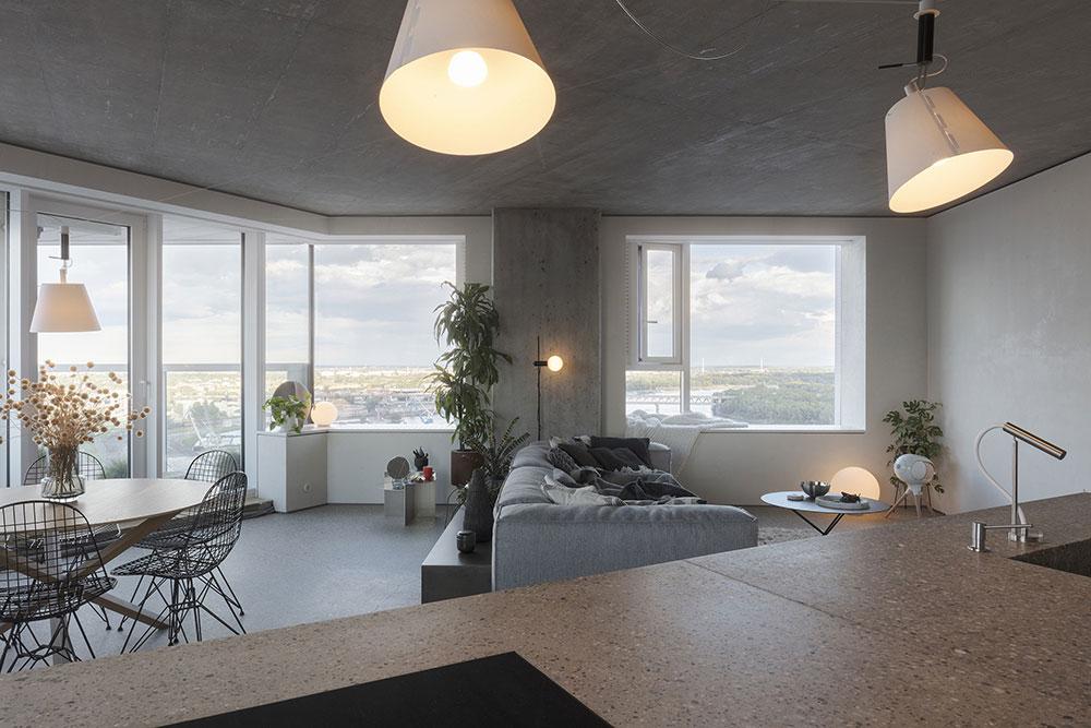 denný priestor bytu so sedacou súpravou, jedálenským stolom a kuchynským ostrovom