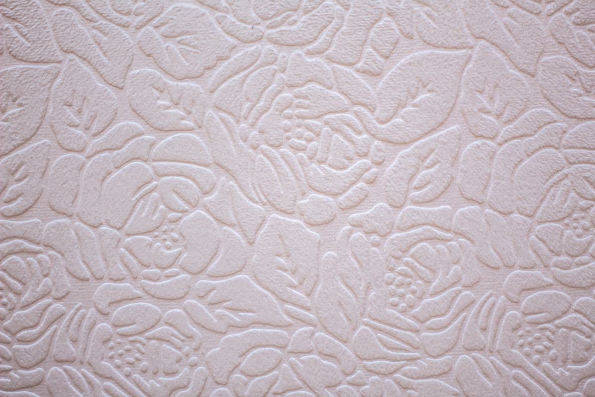 Floral pattern in relief on white paper or fabric